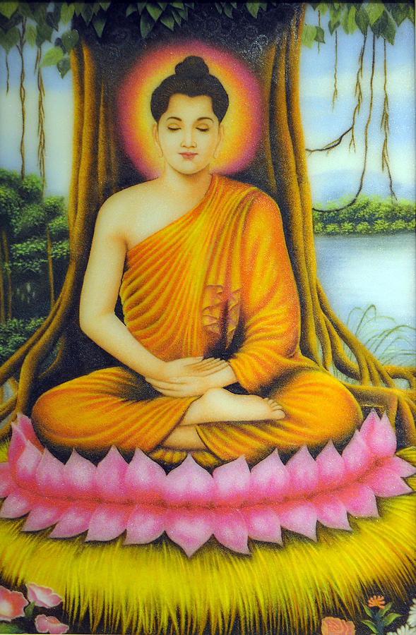 buddha relaxes while sitting under a tree