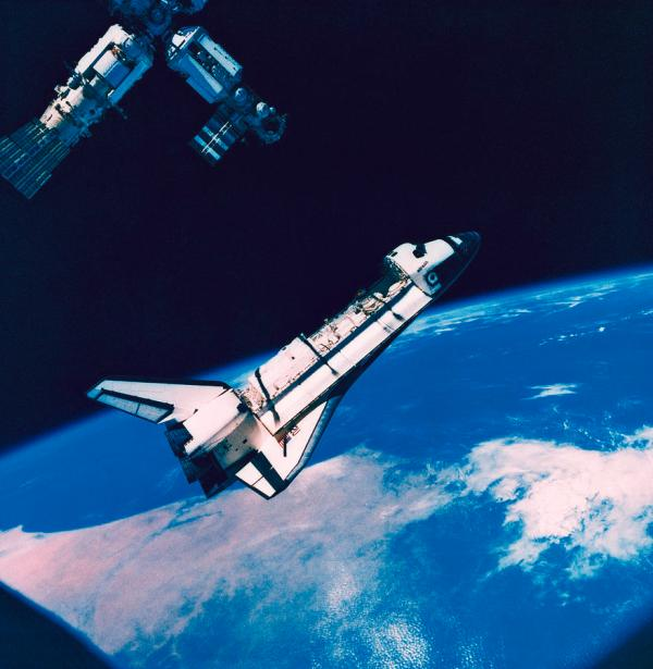 The Space Shuttle And Space Station In Orbit Above The