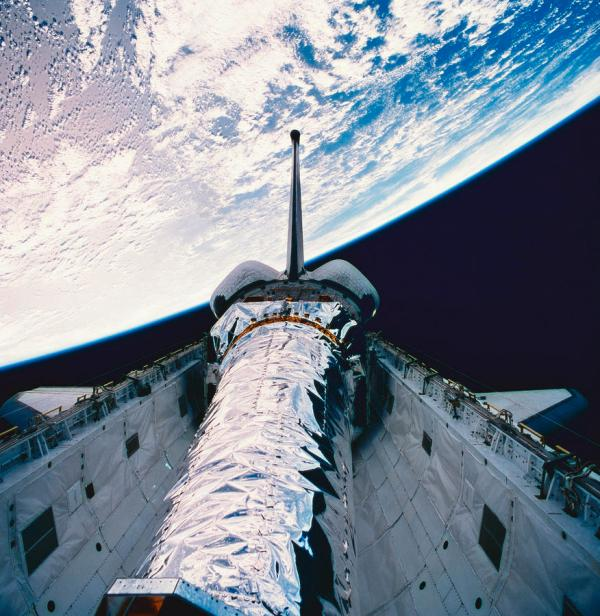 The Space Shuttle With Its Open Cargo Bay Orbiting Above
