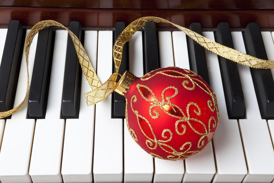 Christmas Ornament On Piano Keys Photograph By Garry Gay