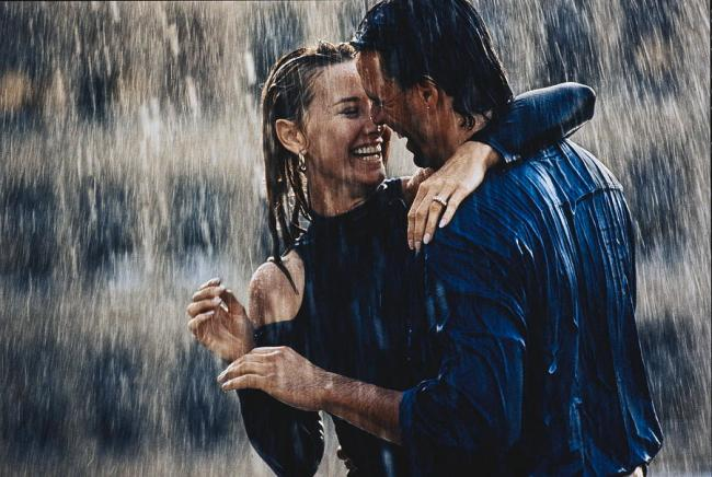 Couple Embracing In Pouring Rain by Bruce Ayres