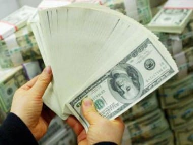 Forex reserves soar over  bn to reach 2 bn on RBIs maiden dollar-rupee swap auction