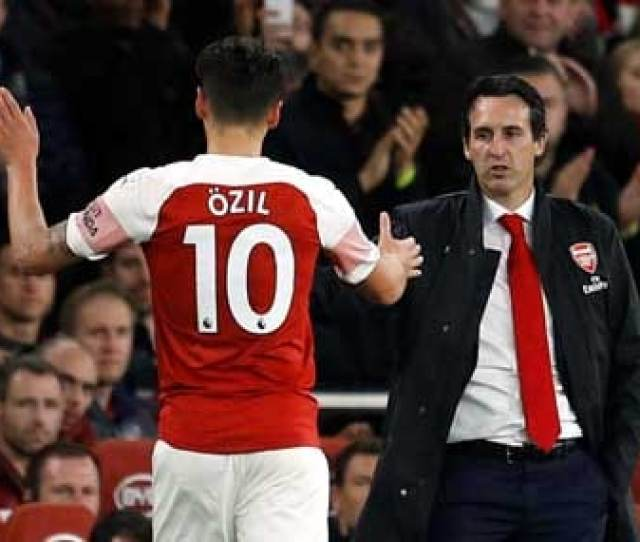 File Image Of Mesut Ozil And Unai Emery Reuters