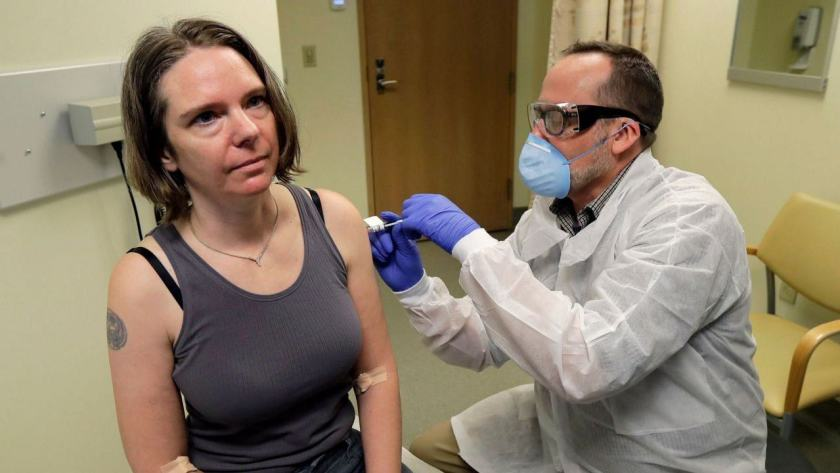 A pharmacist gives Jennifer Haller, left, the first shot in the first-stage safety study clinical trial of a potential vaccine for COVID-19. AP