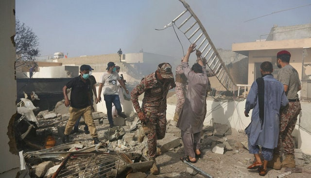 Rescue work is in progress at the site of a plane crash in Karachi. AP