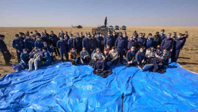 Expedition 64 NASA astronaut Kate Rubins, left, Roscosmos cosmonaut Sergey Ryzhikov, center, and Roscosmos cosmonaut Sergey Kud-Sverchkov sit in chairs outside the Soyuz MS-17 spacecraft after they landed in a remote area near the town of Zhezkazgan, Kazakhstan on Saturday, 17 April 2021. Image credit: NASA/Bill Ingalls/Flickr