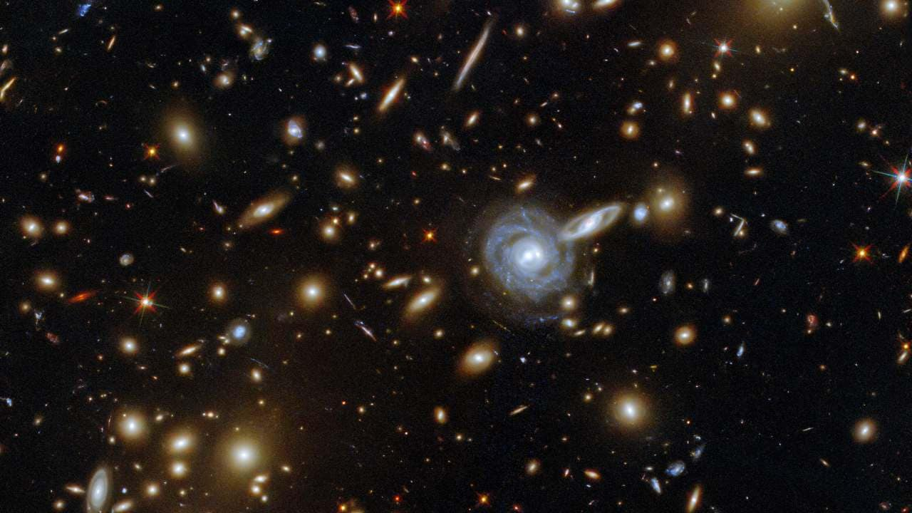 Hubble telescope captures image of unique lopsided spiral galaxy, 120 mn light-years away- Technology News, Gadgetclock