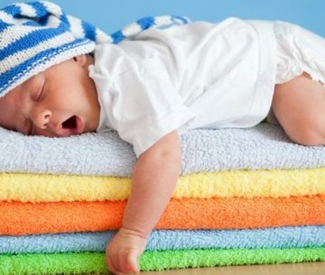 Baby Sleeping On Bright Towels