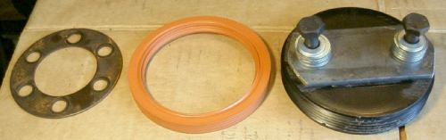 The guide ring, the new seal, and the assembled tool