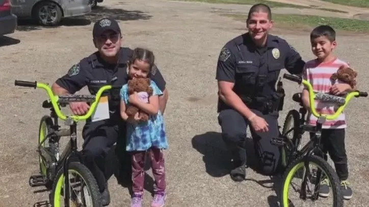 APD officers purchase bikes for children of woman caught in IRS scam