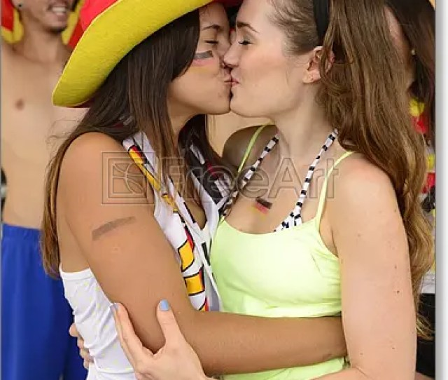 Free Art Print Of Cheerful Couple Of German Lesbian Soccer Fans Kissing Each Other Celebrating Freeart Fa18234008