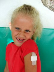 Girl with plaster & missing tooth 1