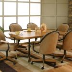 Cramco Inc Shaw Bow End Sunset Oak Laminate Dining Table With 6 Harvest Upholstered Tilt Swivel Arm Chairs Corner Furniture Dining 7 Or More Piece Set