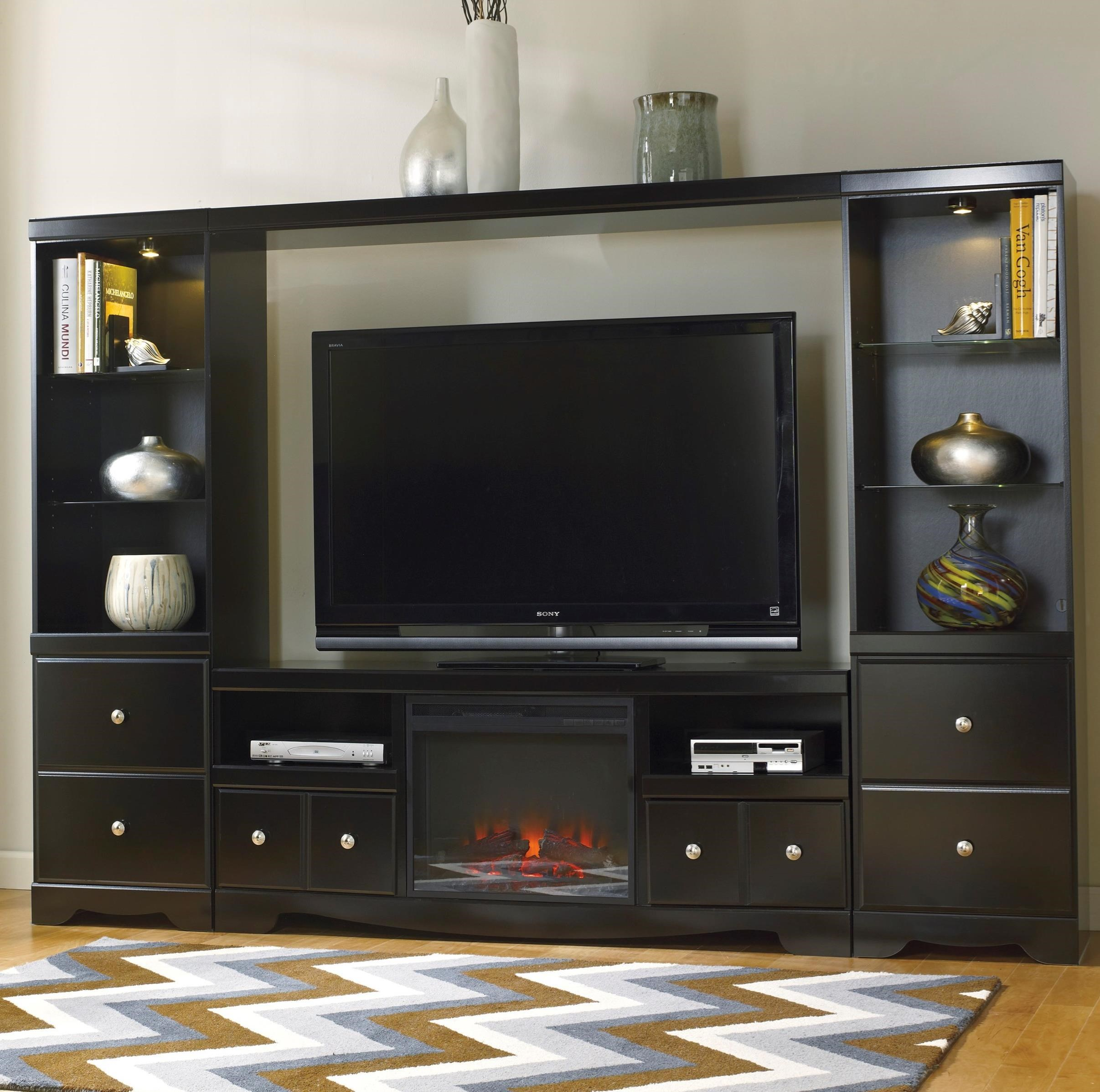 You can order online on valuecityfurniture.com or from a value city furniture store near. Signature Design by Ashley Shay Entertainment Wall Unit w ...