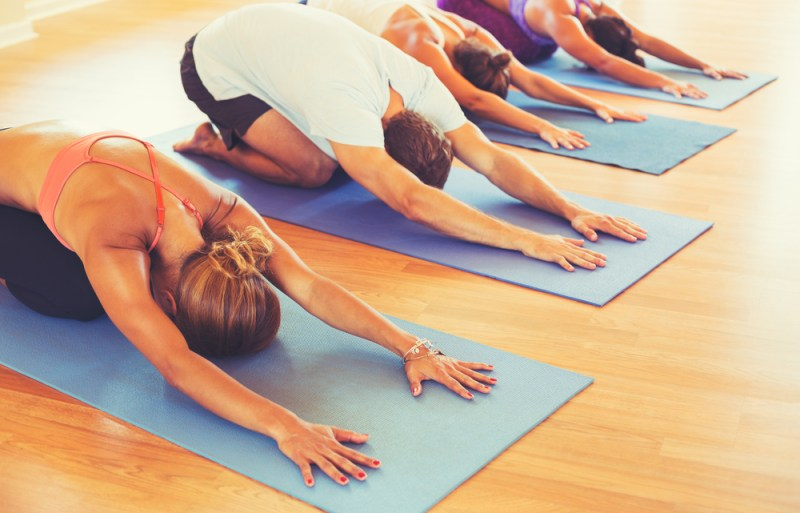 Science says yoga helps the side effects of cancer treatments, and we're rolling out our mat