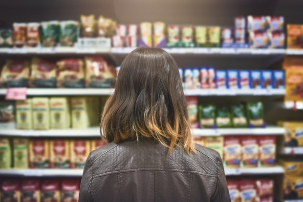 Rearview shot of a woman standing in a grocery aisle