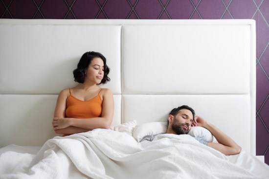 Woman looking at man unsatisfied after sex