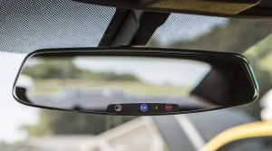 Image: 2013 Chevrolet Camaro's frameless rearview mirror with electrochromic OnStar buttons