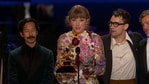 Taylor Swift accepts the Album of the Year award at the Grammys 2021.