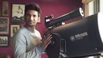 Sushant Singh Rajput poses with his telescope.