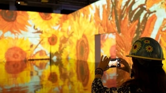 Members of the media tour the Immersive Van Gogh show, Wednesday, May 26, 2021 at Pier 36 in New York. The exhibit celebrates the work of the 19th century Dutch impressionist painter.(AP)