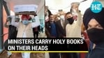 Union ministers received evacuees from Afghanistan, helped carry copies of Guru Granth Sahib through Delhi airport (ANI)