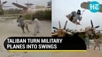 Video of Taliban fighters riding swing on military plane tweeted by Chinese government official (Twitter)