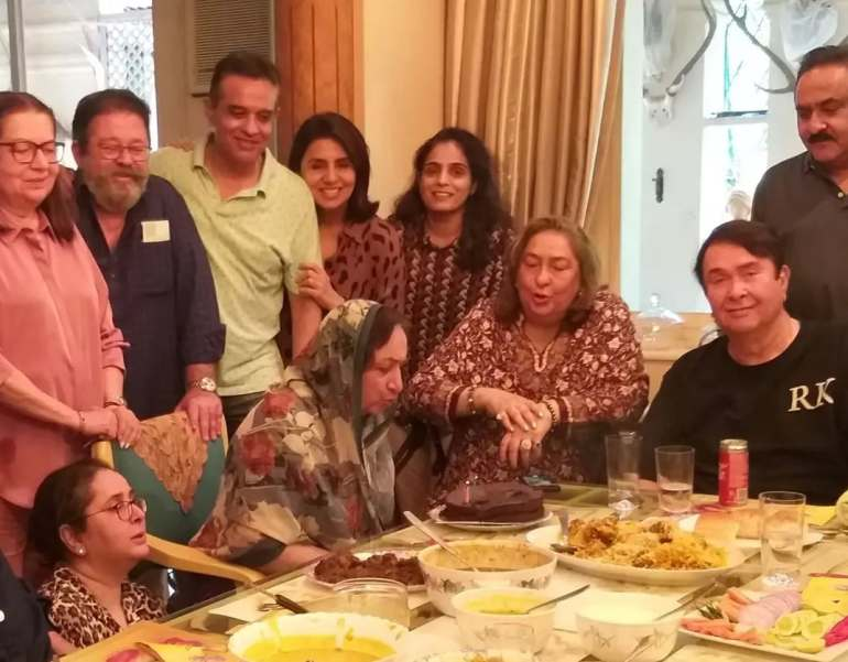 Neela Kapoor blowing out the candles on the cake.