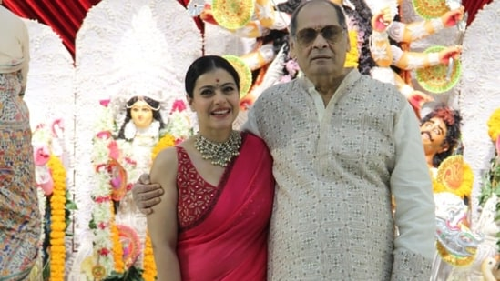 Kajol with her uncle at the Durga Puja pandal. She broke down when she met him and was seen sobbing and hugging him. (Varinder Chawla)