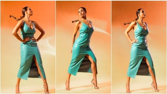 Malaika Arora, who is currently seen hosting the show, Supermodel of The Year along with co-hosts Milind Soman and Anusha Dandekar, recently rocked a thigh-high slit blue leather dress.(Instagram/@manekaharisinghani)