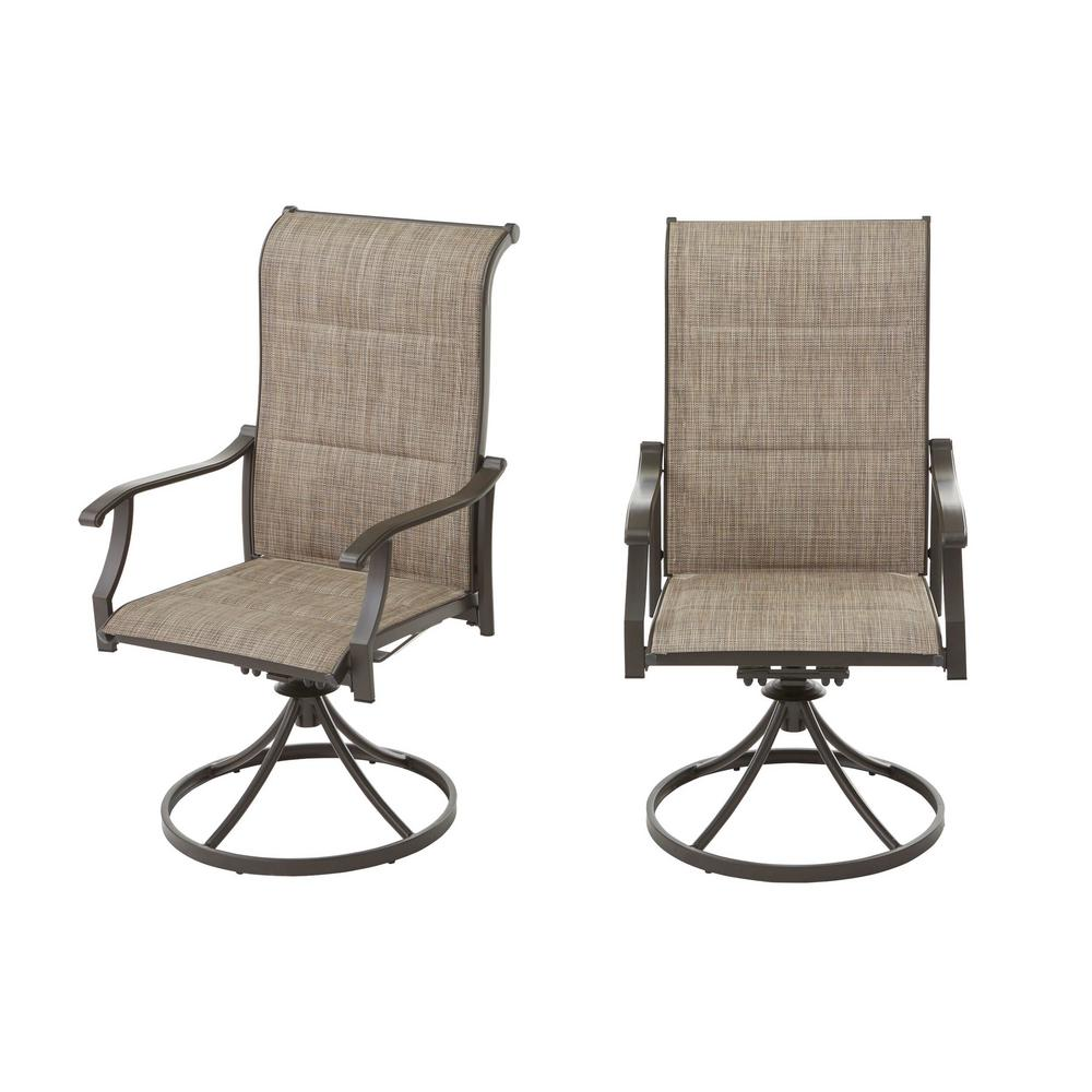 2 tan outdoor dining swivel chairs