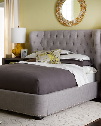curved wingback, tufted linen upholstered bed, nailhead trim