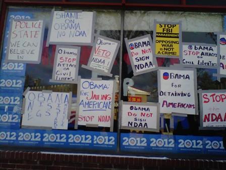 2011-12-24-NDAAprotestsignsatObamasweb.jpg