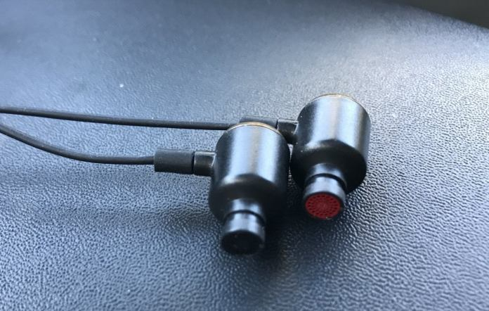 Right and left is designated by the color of the headphone grille. Ear tips removed for clarity.