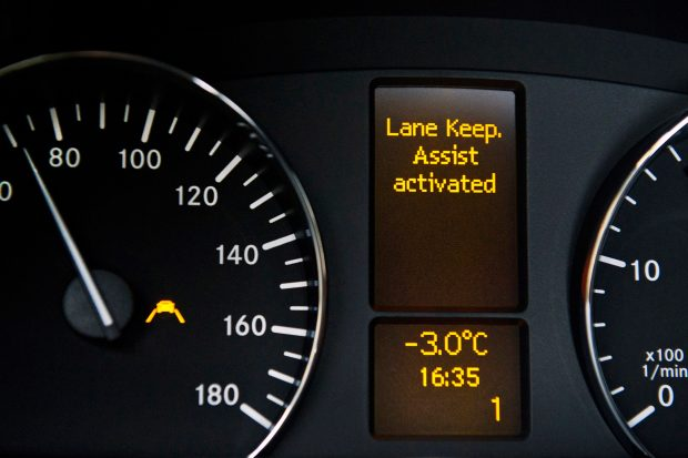 Car dashboard with lane-keeping assist activated