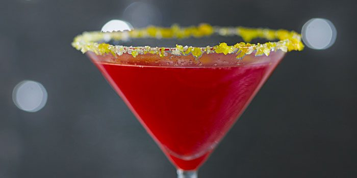 Margarita in glass with orange sugar rim