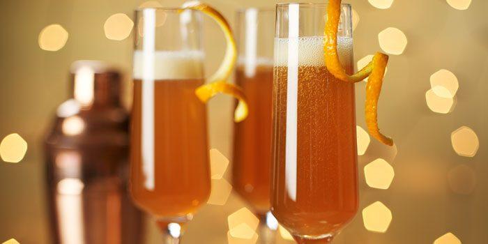 Cocktails with orange peel on tray