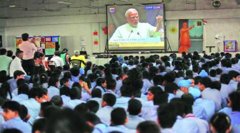 Students watch live telecast of PM Narendra Modi's speech at KBDAV School in Chandigarh on Friday. (Source: Express photo by Jaipal Singh)