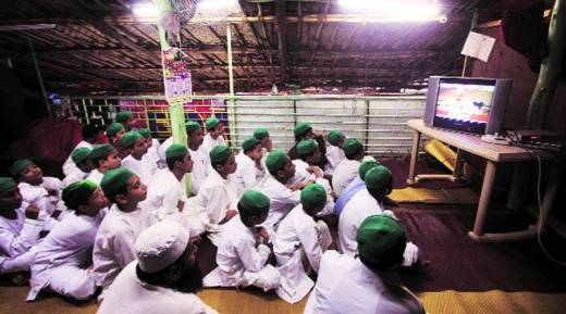 Teachers' Day. Madrasa students in Mumbai watch Modi speak.(Express Photo by: Prashant Nadkar)