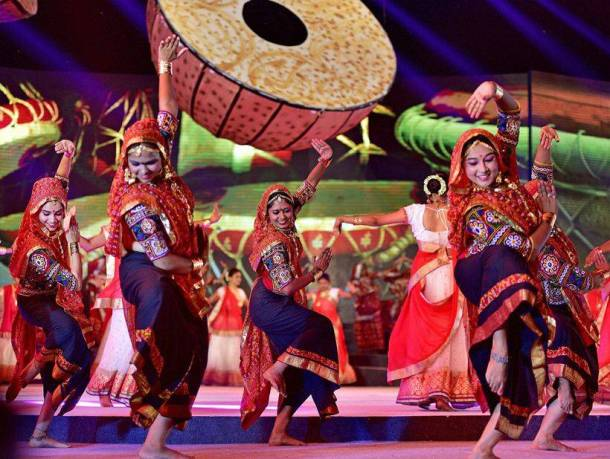 PHOTOS: People Take Part In Dandiya Raas During Garba