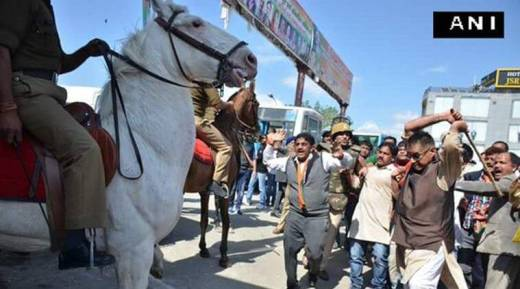 BJP MLA lathicharging a police horse in Dehradun on Monday. ANI photo