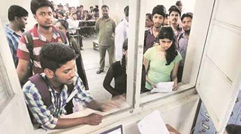 Students submitting forms for FYJC admissions at Garware College on Tuesday.Express Photo By Sandeep Daundkar, Pune, 09.06.2015
