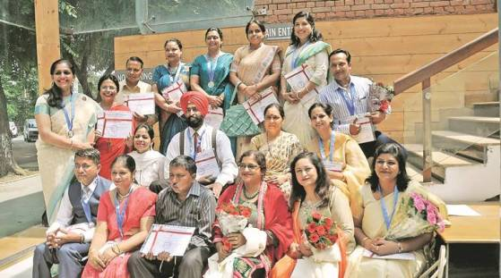 Teachers with their awards at Tagore Theatre in Sector 18 on Monday.