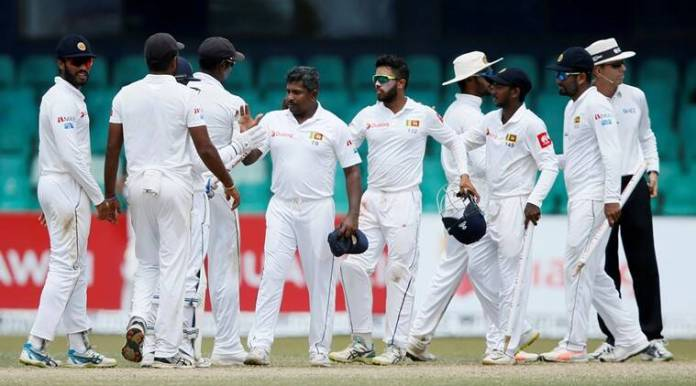 Sri Lanka's Rangana Herath (C) celebrates with his teammates taking six wickets after they won the test series