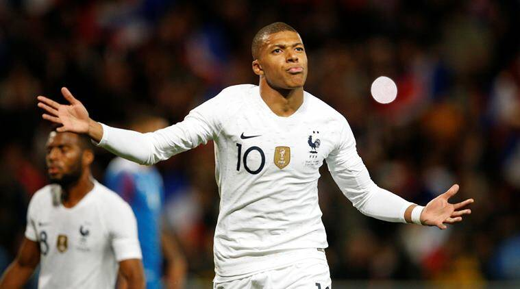 France's Kylian Mbappe celebrates scoring their second goal against Iceland.