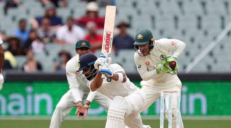 India's Virat Kohli plays and misses at the ball while batting during the first cricket test between Australia and India in Adelaide, Australia