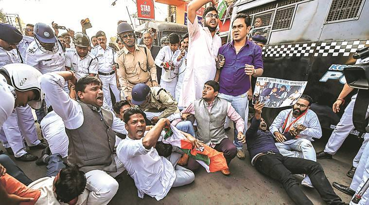 Police detain Youth Congress workers during a protest march against the Centre for alleged misuse of CBI, in Kolkata Monday. PTI