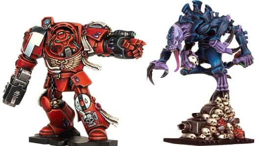 The barely more recognisably human space marine (left) and genestealer (right).