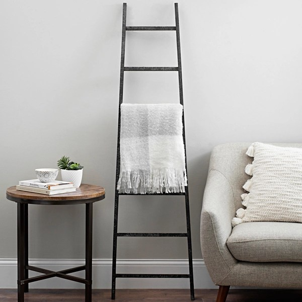 black distressed wood leaning ladder