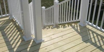 Deck Cost Landscaping Network | Wood Railing On Concrete Porch | Surface Mount | Wood Decorative | Vinyl | Front Entry Stair | Bluestone Patio